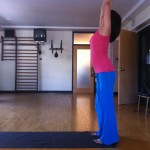 prenatal yoga standing pose with arms overhead