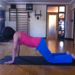 Prenatal variation of plank position with knees on the floor almost 19 weeks pregnant