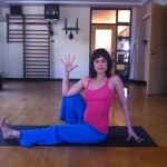 Prenatal yoga open seated twist in early second trimester