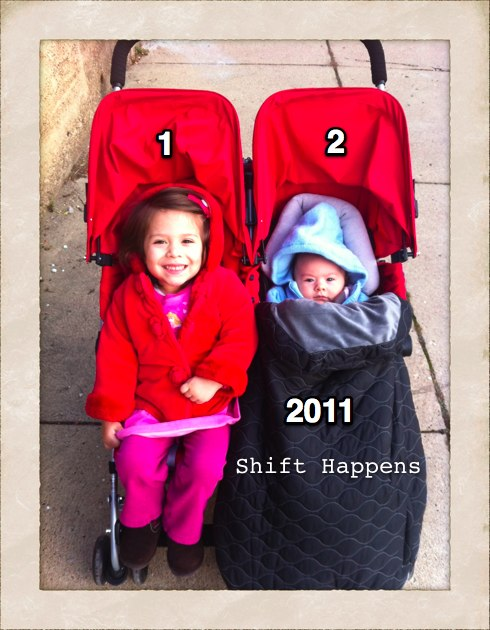 my girls Hunter Rose and Mae Anne in their double stroller